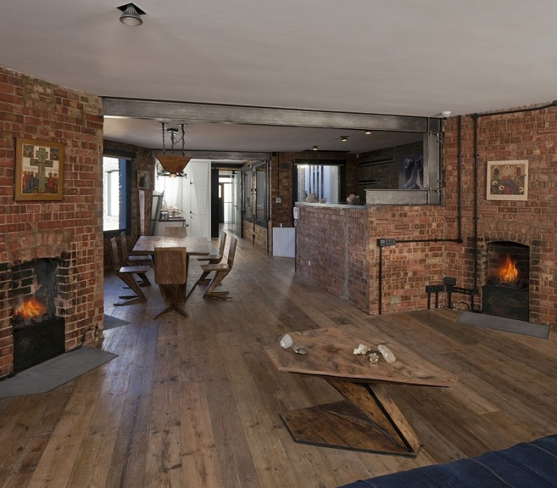 traditional-fireplaces-and-the-brick-walls-give-the-home-a-classic-english-look