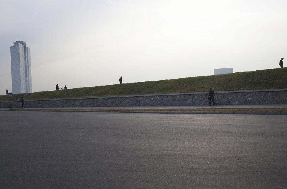 North Korean commuters make their way along a Pyongyang city street.