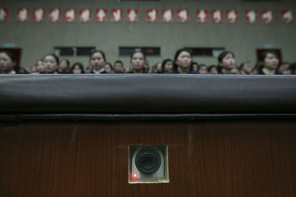 A camera in the wall, used to film inside an auditorium at the Mangyongdae Schoolchildren's Palace in Pyongyang, North Korea, records as children wait for a performance to begin Wednesday, Feb. 27, 2008. (AP Photo/David Guttenfelder)