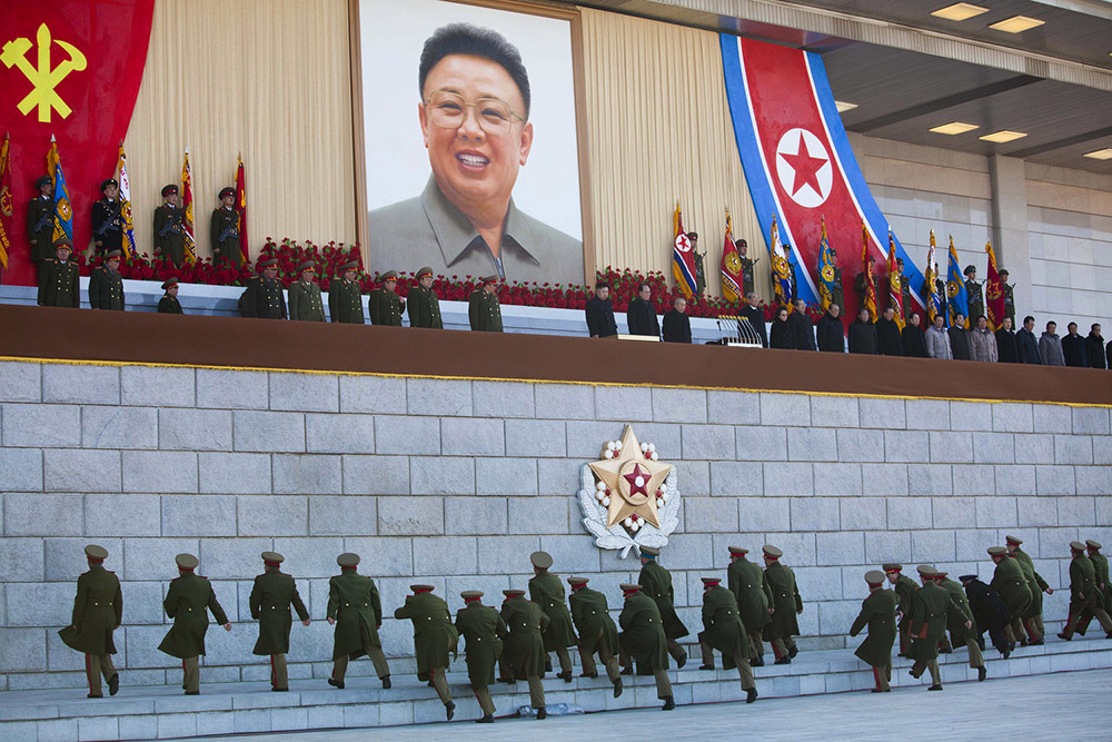 Senior North Korean military members approach an area where new North Korean leader Kim Jong Un and other military and political leaders stand at Kumsusan Memorial Palace in Pyongyang before reviewing a parade of thousands of soldiers and commemorating the 70th birthday of the late Kim Jong Il on Thursday, Feb. 16, 2012. (AP Photo/David Guttenfelder)
