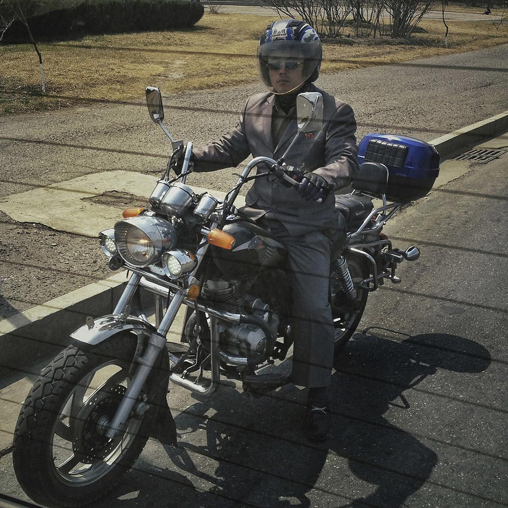 A North Korean man rides his motorcycle in central Pyongyang.