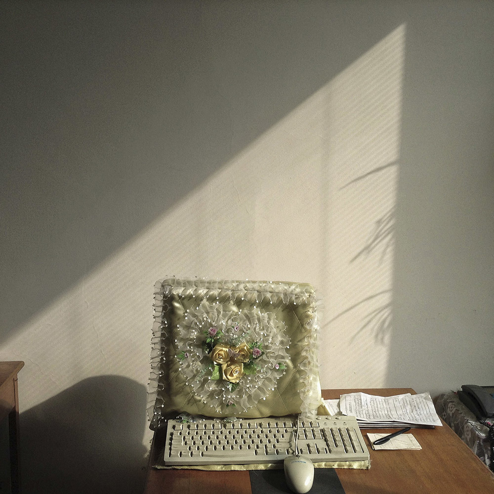 In this Feb. 20, 2013 photo taken with an iPod Touch and originally posted to instagram from Pyongyang, North Korea, a frilly yellow dust cover protects a desktop computer monitor inside a Pyongyang, North Korea office. (AP Photo/David Guttenfelder)
