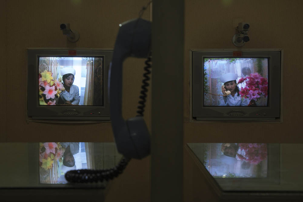 North Korean nurses speak on telephones at a video conference booth inside the Pyongyang Maternity Hospital. Hospital officials say that new mothers and infants are expected to stay isolated from the public, and the possible germs they carry, for at least a week after their baby is born. These conference booths allow visitors to see the newborns and speak to the mothers from a seat in the lobby. Photo by David Guttenfelder