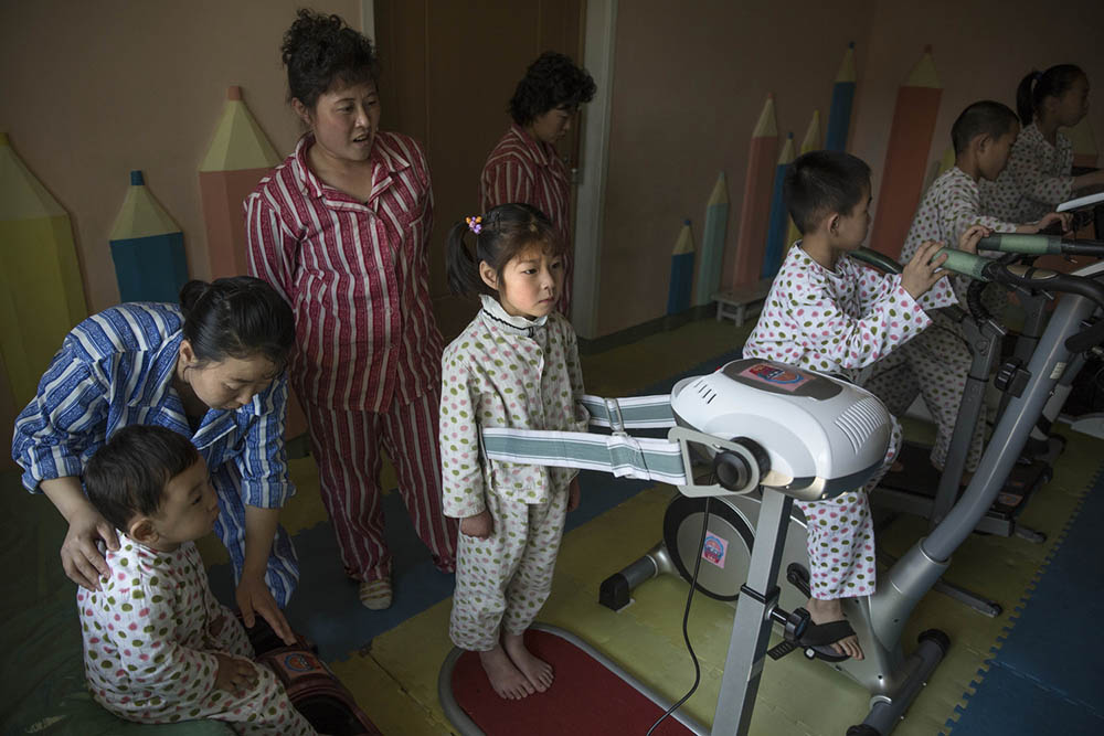 Patients at the Okryu Children's Hospital in Pyongyang use a facility for physical rehabilitation including stationary bicycles and a vibrating belt exercise machine. Photo by David Guttenfelder