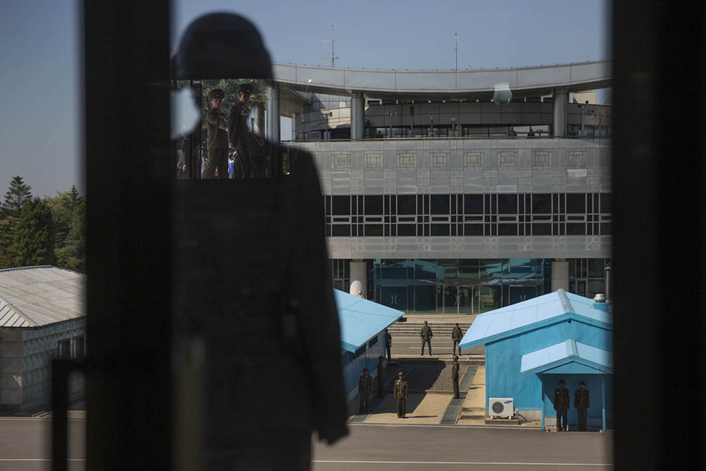 Looking north to south across the Demilitarized Zone (DMZ), North and South Korean soldiers face off across the line in Panmunjom, North Korea. The DMZ has separated the two halves of the Korean peninsula since the Armistice agreement was signed over six decades ago ending direct hostilities. Photo by David Guttenfelder