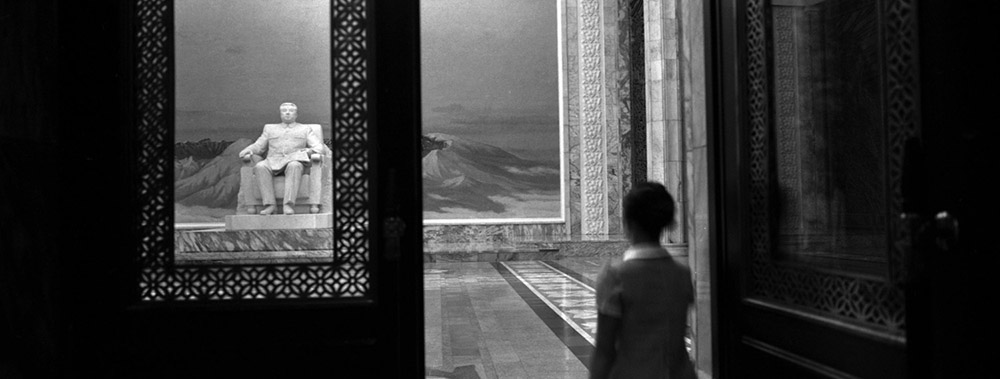 A woman enters the front doors of the Grand People's Study House where a statue of the late leader Kim Il Sung stands in Pyongyang, North Korea.