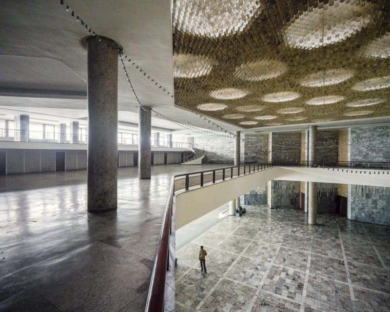 Pyongyang International Cinema House, interior. A man is standing in the empty hall as the cinema complex is mostly out of service and only used for special occasions such as the Pyongyang International Film Festival, held every 2 years.