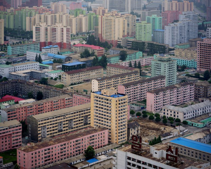 View of East Pyongyang from the Juche Tower. Here the homogenous design of the city and absence of visual pollution from commercial advertising become apparent. As well as the very linear and raw structures of most buildings.